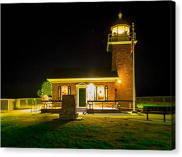 Night Lighthouse Canvas Print by Steve Spiliotopoulos