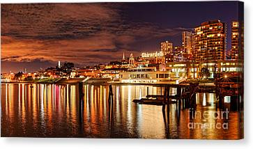 Night Panorama Of Fisherman's Wharf And Ghirardelli Square - San Francisco California Canvas Print by Silvio Ligutti