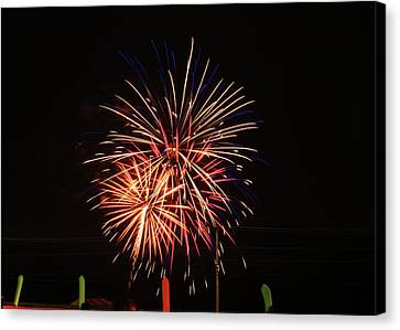Night Sky With Fireworks Canvas Print by Laura Catherine