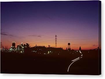 Night View Of An Industrial Plant Canvas Print by Kenneth Garrett