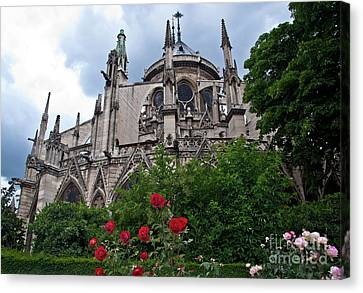 Notre Dame With Rose Garden Canvas Print by Loriannah Hespe