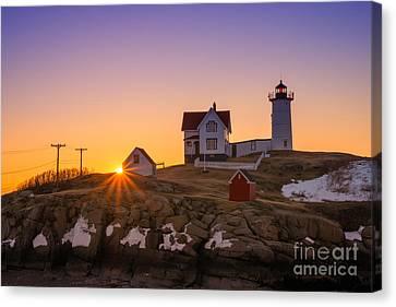 Nubble Lighthouse Sunburst Canvas Print by Michael Ver Sprill