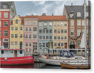 Canvas Print featuring the photograph Nyhavn Waterfront In Copenhagen by Antony McAulay