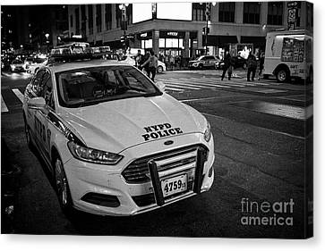 nypd ford fusion police cruiser parked on the street at night New York City USA Canvas Print by Joe Fox