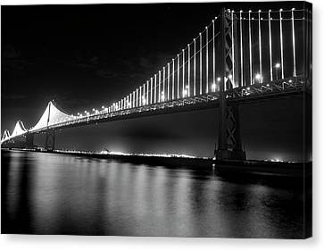 Canvas Print featuring the photograph Oakland Bay Bridge At Night by Darcy Michaelchuk