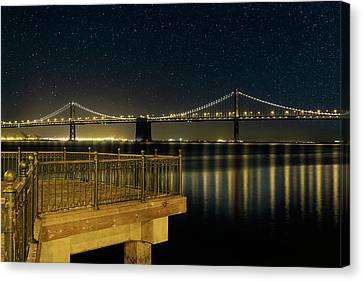 Canvas Print - Oakland Bay Bridge By The Pier In San Francisco At Night by David Gn