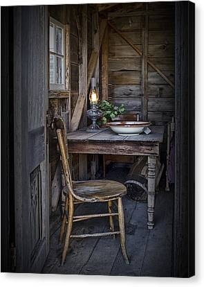 Cabin Window Canvas Print - Oil Lamp With Vintage Chair And Table Setting by Randall Nyhof