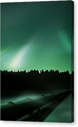 Oil Pipeline And Aurora Canvas Print by Richard Kail