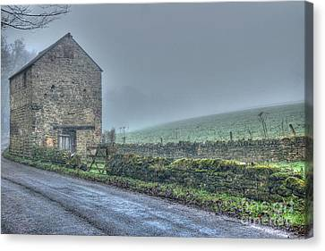 Old Barn On A Misty Day Canvas Print by David Birchall
