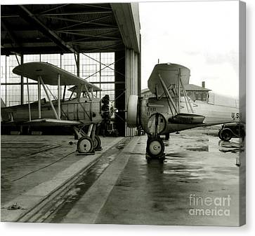 Vintage Airplane Canvas Print - Old Biplanes In A Hanger  by Jon Neidert