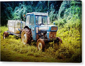 Old Blue Ford Tractor Canvas Print by John Williams
