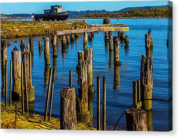 Old Boat And Pier Posts Canvas Print by Garry Gay