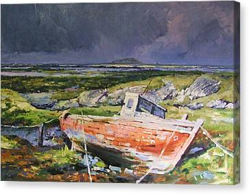 Old Boat On Shore Canvas Print by Conor McGuire