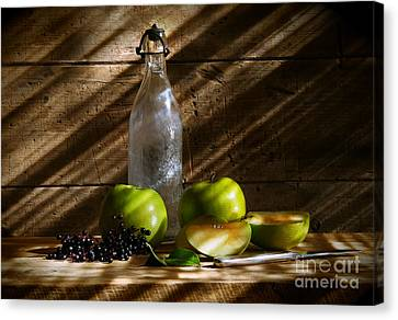 Old Bottle With Green Apples Canvas Print by Sandra Cunningham