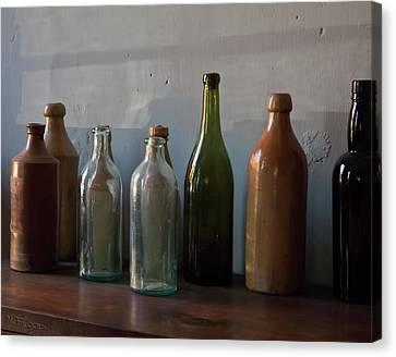 Old Bottles In North Light Canvas Print by Michael Flood