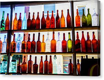 Old Bottles In Window Canvas Print by Garry Gay