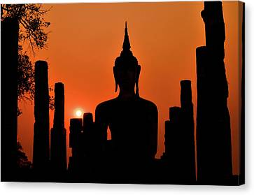 Old Buddha Silhouette In Sukhothai Historical Park Canvas Print