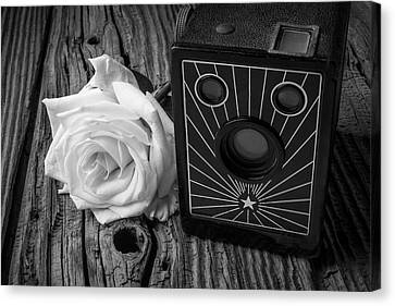 Old Camera And White Rose Canvas Print by Garry Gay