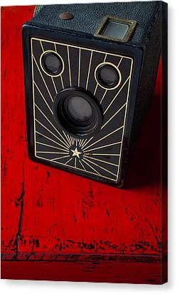 Old Camera On Red Table Canvas Print by Garry Gay