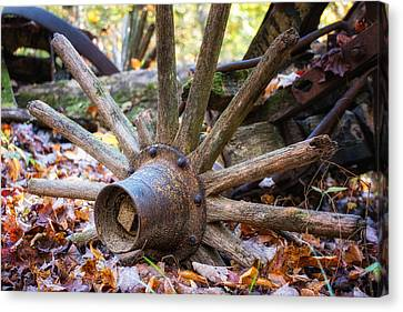 Old Decaying Wagon Wheel Canvas Print by Tom Mc Nemar