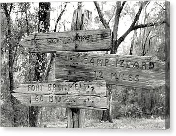 Old Directional Signs At Fort Cooper  Canvas Print by Debra Forand