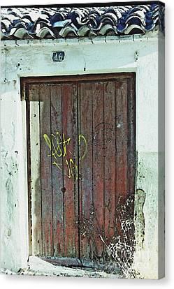 Old Door In Alcantarilla Canvas Print by Sarah Loft