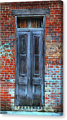 Old Door With Bricks Canvas Print by Perry Webster