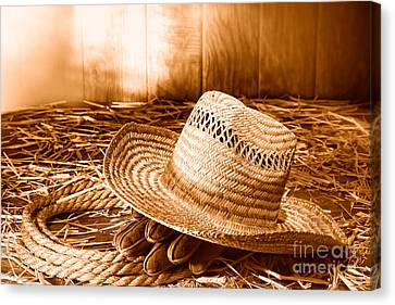 Old Farmer Hat In Hay Barn - Sepia Canvas Print by Olivier Le Queinec