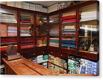 Old-fashioned Fabric Shop Canvas Print by Gaspar Avila