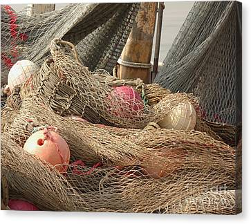 Old Fishing Nets With Floats Canvas Print by Yali Shi