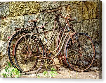 Old French Bicycles Canvas Print by Debra and Dave Vanderlaan