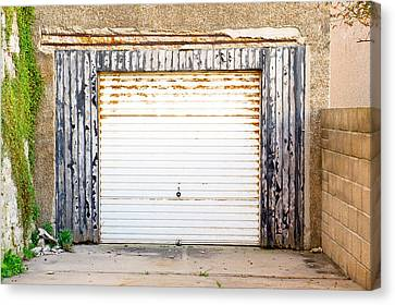 Old Garage Door Canvas Print by Tom Gowanlock