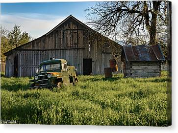 Old Jeep, Old Barn Canvas Print by Mike Ronnebeck
