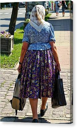 Canvas Print featuring the photograph Old Lady Off To Work by Mariola Bitner