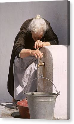 Old Lady With Water Pail Canvas Print by Carl Purcell