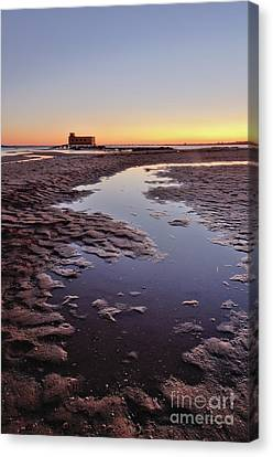 Old Lifesavers Building At Twilight Canvas Print by Angelo DeVal