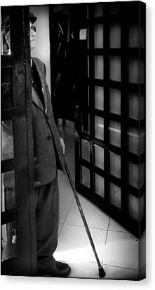 Old Man At The Door Canvas Print by Daniel Gomez