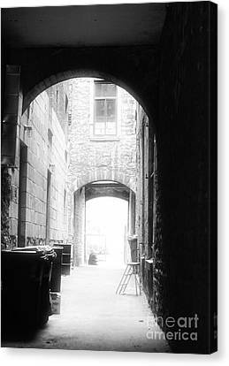 Old Montreal Alley Canvas Print by John Rizzuto