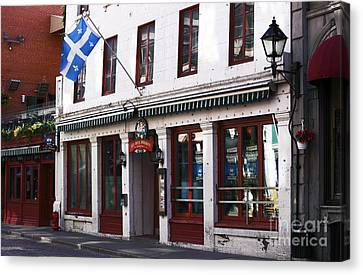 Old Montreal Storefront Canvas Print by John Rizzuto