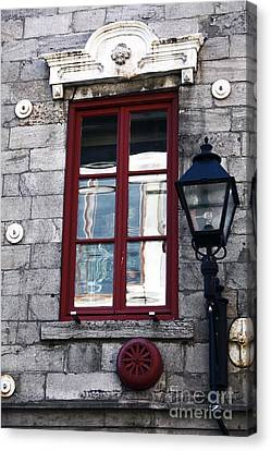Old Montreal Window Canvas Print by John Rizzuto