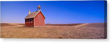 Old Red Schoolhouse On Prairie, Battle Canvas Print by Panoramic Images