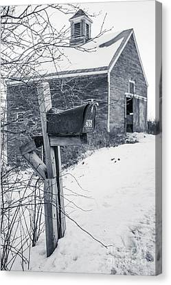 Old Rural Mailbox In Front Of An Old Barn Canvas Print by Edward Fielding