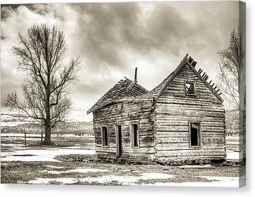 Old Rustic Log House In The Snow Canvas Print by Dustin K Ryan