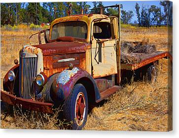 Old Rusting Flatbed Truck Canvas Print by Garry Gay