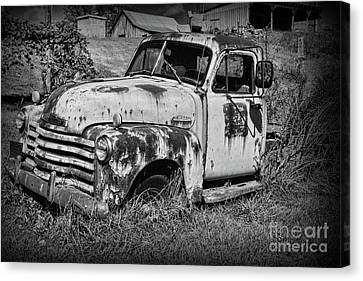 Old Rusty Chevy In Black And White Canvas Print by Paul Ward