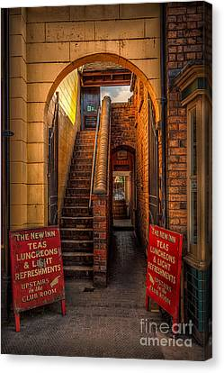 Old Signs Canvas Print by Adrian Evans