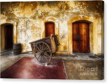 Old Spanish Fort Interior With A Wooden Cart And A Barrel Canvas Print by George Oze