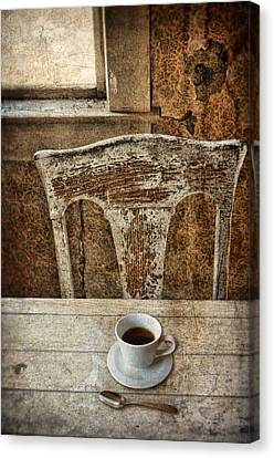 Old Table And Chair With Coffee Canvas Print by Jill Battaglia