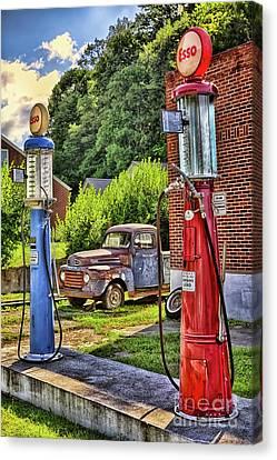 Canvas Print featuring the photograph Old Time Vintage Gas Pumps by Dan Carmichael