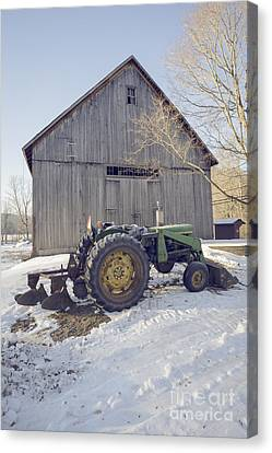 Old Tractor By The Barn Canvas Print by Edward Fielding